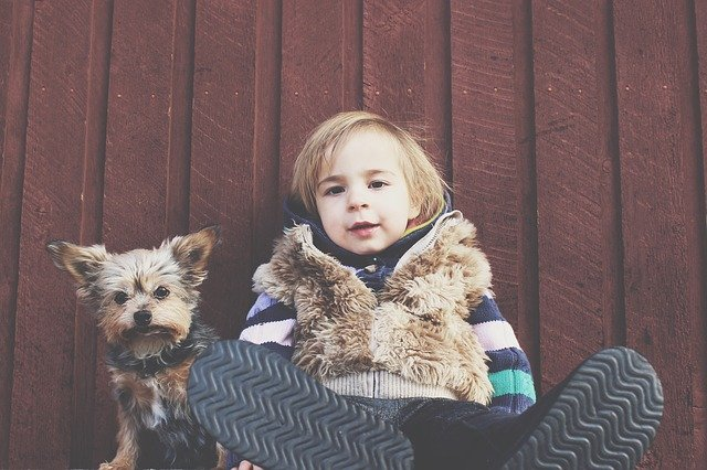 Young boy with dog.