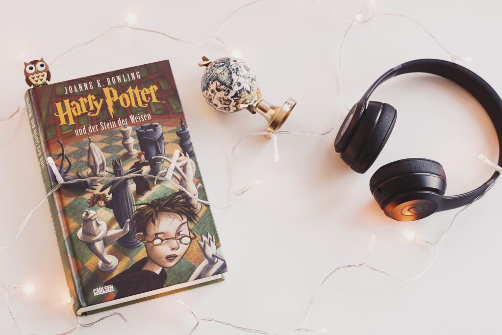Copy of Harry Potter and headphones.