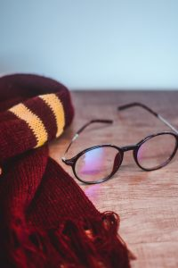 Red scarf and glasses.