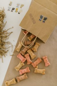 Dog treats from a paper bag.