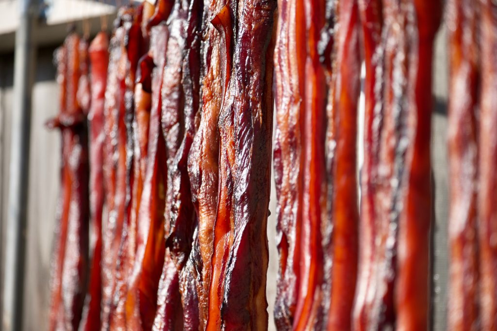 Row of hanging bacon.