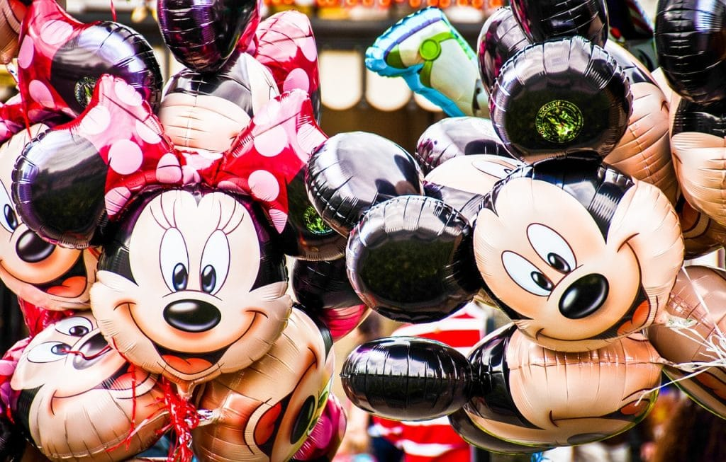 Mickey Mouse and Minnie Mouse balloons.