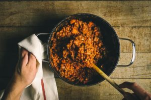 Person cooking lentils.